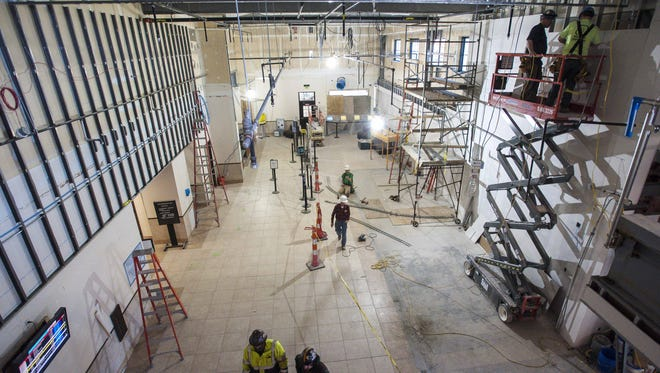 Construction is underway in the main concourse at the Plattsburgh International Airport on Friday, March 18, 2016. The airport is in the midst of a two-year expansion project.
