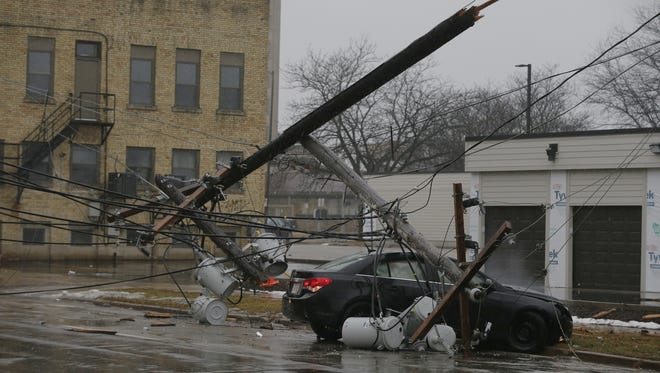 A single-car crash took out two power poles Monday Jan. 22, 2018, on Waugoo Avenue in Oshkosh, knocking out power to more than two dozen Wisconsin Public Service customers.