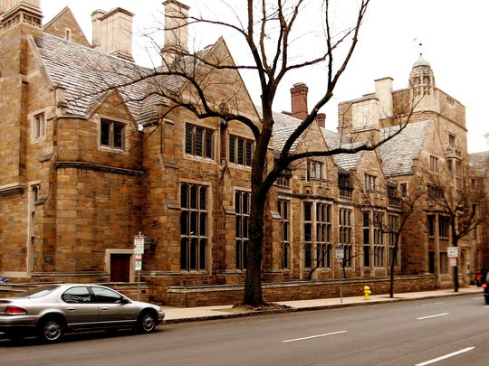 This Feb. 2, 2007 photo shows Calhoun College, one of the 12 residential colleges housing Yale undergraduates at Yale University in New Haven, Conn. Some institutions outside the South are reconsidering whether to still honor historical figures with ties to slavery and the Confederacy. There's also a push to strip the name of John C. Calhoun, a white supremacist, from the building at Yale University.