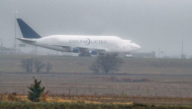 A Boeing Dreamlifter sits on a runway Nov. 21, 2013, the day after it mistakenly landed at Col. James Jabara Airport in Wichita.