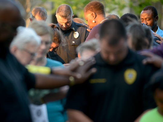 People were asked to lay hands on Chief Julian Wiser