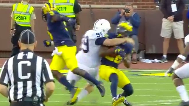 Penn State kicker Joey Julius tackled Michigan returner Jourdan Lewis.