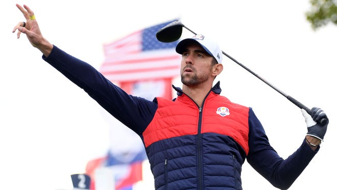 US swimmer Michael Phelps reacts to drive on the second hole in the celebrity tournament during a practice for the 41st Ryder Cup at Hazeltine National Golf Club.