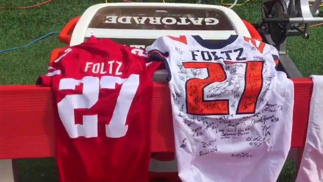 Illinois gave Nebraska a signed Sam Foltz jersey before the game on Saturday.