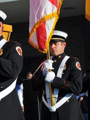Battalion Chief Anthony Gianantonio, seen presenting the colors at a prayer vigil, has been selected to serve as Grice's successor as deputy chief.