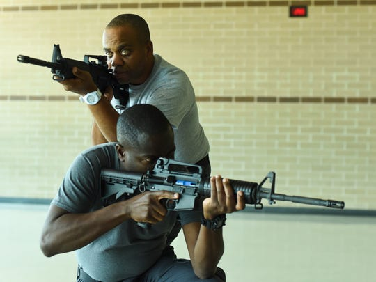 Oluyemi  Mashama and Ronald Davis-Francis of the Trinidad and Tobago police force participate in active-shooter training Friday at West De Pere High School. The training was held in conjunction with an International Police Association conference that took place in the Green Bay area throughout the week.