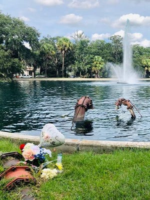 A memorial stands along the edge of the Daffin Park lake, marking the spot where a 3-year-old boy drowned earlier this year.
