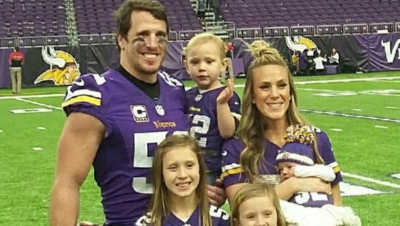 Chad Greenway is shown with Maddyn (9), Beckett (6),