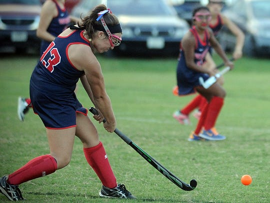 Worcester Prep's Abbi Nechay fires a shot during the