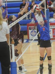 Cooper's Caylee Collier, right, battles a Midland Lee