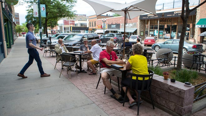 People spend time at Carpenter Bar in downtown Sioux Falls, S.D. Wednesday, June 6, 2018.