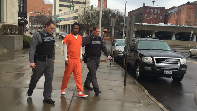Rashawn Cauthen leaving federal court in Binghamton after pleading guilty to charges of drug trafficking conspiracy and carrying a firearm.