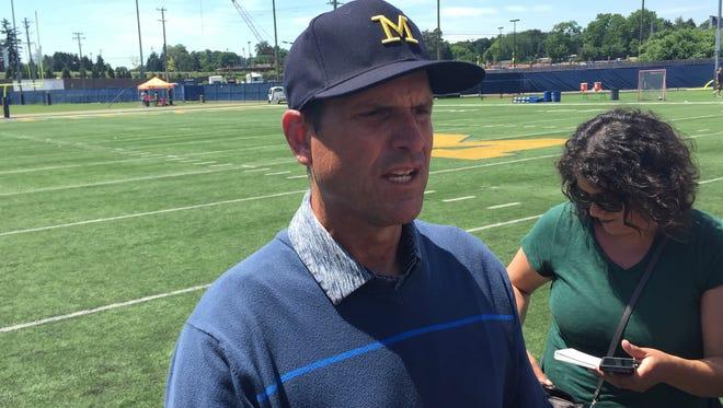 Michigan coach Jim Harbaugh during the U-M Aerial Assault camp June 18, 2016, in Ann Arbor.