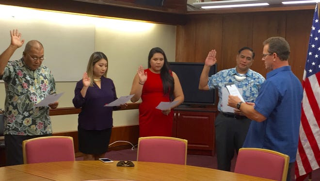 Lt. Gov. Ray Tenorio, right, administers the oath of office Thursday morning to Guam Academy Charter School Council members Ansito Walter, Yuka Oguma, Amanda Blas and Francis Toves. With five members including Superintendent Jon Fernandez, the council now has quorum to conduct official business including oversight of two existing charter schools and review of applications for proposed charter schools.