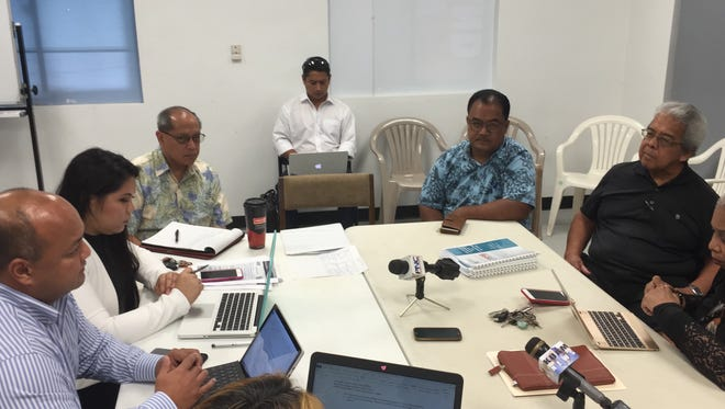 Guam Academy Charter Schools Council chairperson Amanda Blas, second from left, and other members ask Guahan Academy Charter School board member Victor Perez and others about the factors holding up the school's reopening, during a work session Wednesday Sept. 13, 2017.