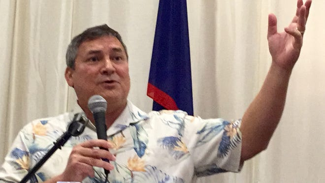 Gov. Eddie Calvo gestures as he addresses members of the Guam Contractors Association on Sept. 20, 2017 at Hyatt Regency.