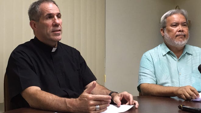 Archbishop Michael Jude Byrnes, left, talks about a complete revamp of the Archdiocese of Agana's sexual abuse policy, the safe environment program, and the independent review board policy, during a Tuesday afternoon news conference. Also in photo is the archdiocese's director of communications, Tony Diaz. The archdiocese faces nearly 140 clergy sex abuse lawsuits in local and federal court as of Oct. 24, 2017.