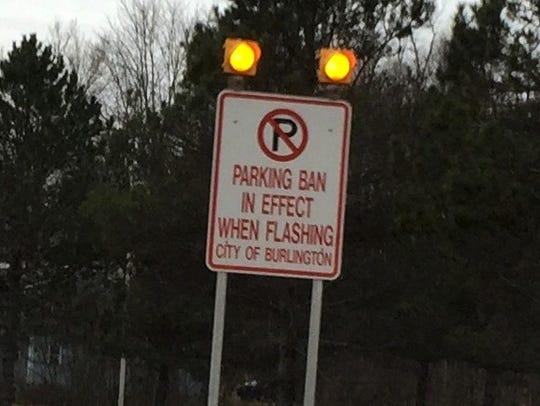 A sign alerts motorists that Burlington's parking ban