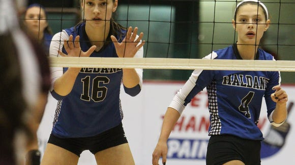 Haldane's Kelly Vahos (16) and sister Brooke (4) at the 2014 NYSPHSAA volleyball championships in Glens Falls. Nov. 16, 2014.