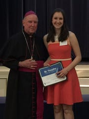 Elizabeth Dawson '17) was presented with the St. Timothy Award from Bishop Francis Malooly.