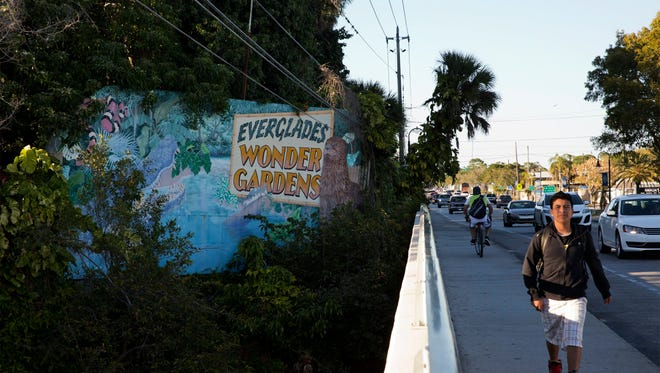 Barber-shave style signs that advertise the Everglades Wonder Gardens dot Old 41 Road in Bonita Springs in 2015.