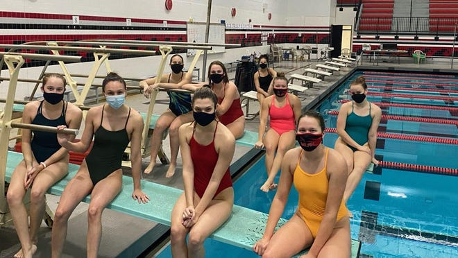 Milan's girls swimming and diving team gathered at the school's pool Monday, the day after the Michigan Department of Health and Human Services announced that all high school sports are being suspended.