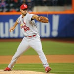 Apr 22, 2014; New York, NY, USA;  St. Louis Cardinals starting pitcher Adam Wainwright (50) pitches during the first inning against the New York Mets at Citi Field. Mandatory Credit: Anthony Gruppuso-USA TODAY Sports