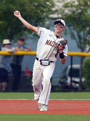 Madison's Vince Costa looks to throw to first vs. Pascack