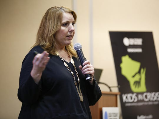 Annie Short, chairman of Healthiest Manitowoc County, directs a workshop on suicide prevention during the Kids in Crisis town hall meeting at the Manitowoc Public Library on March 28 in Manitowoc.