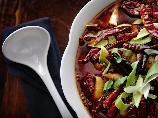 The boiled fish in chili oil at Mulan is a spicy szechuan favorite with catfish chili peppers and szechuan peppercorn.  Mulan, which specializes in authentic szechuan cuisine, has opened a new location in the Audubon Place shopping center on Spottswood.