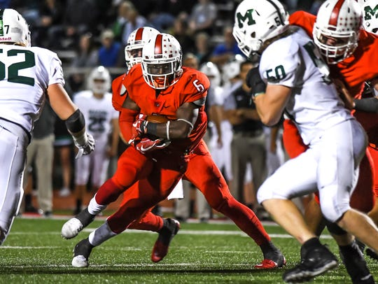 Colerain running back Deante Smith-Moore (6) runs the