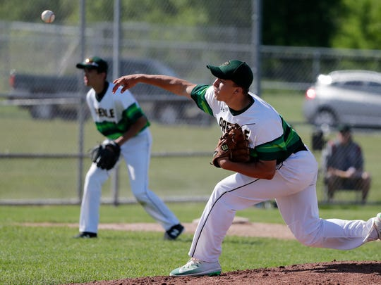 Green Bay Preble's Max Wagner (9) pitches against Antigo