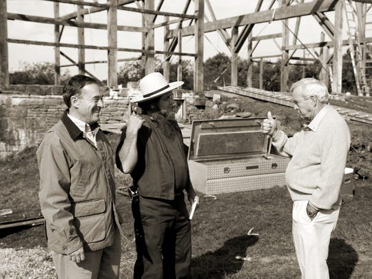 The late Arnold Palmer, right, and Bass Pro Shops founder and CEO Johnny Morris, left, supervise the dismantling of a barn from Palmer's hometown of Latrobe, Pennsylvania.