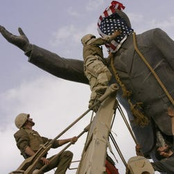 Toppling a statue of Saddam Hussein in April 2003.