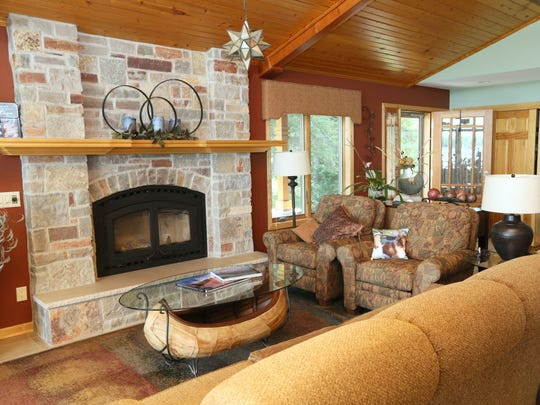 Jeff Otto redid the fireplace bricks three separate times until he was happy with the way it looked. He was so happy, he even used the bricks on the outside of his home.