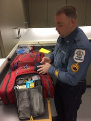 Cpl. David McKinney, with New Castle County Paramedics, packs his medical bag before the start of a 10-hour day shift in January.