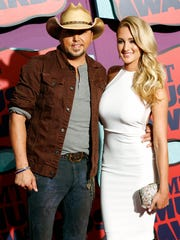 Jason Aldean and Brittany Kerr are now engaged, but two years ago they made tabloid headlines after a photo surfaced of the pair kissing. Aldean was married at the time.