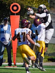 St. Cloud State tight end Grant Thayer leaps to make