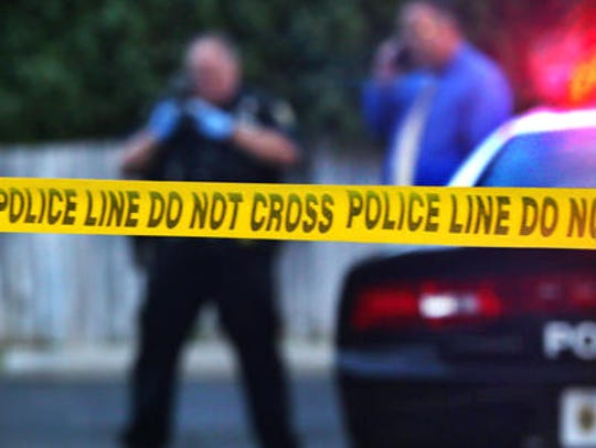 Police respond to a crime scene in Indianapolis.