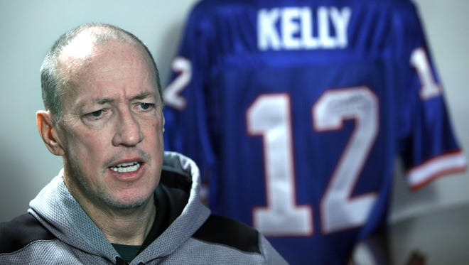 Jim Kelly, pictured during and interview with Democrat and Chronicle reporter Sal Maiorana, was recently declared cancer-free.