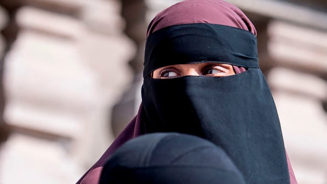 In this file photo taken on May 31, 2018 women wearing niqab leave the Danish Parliament in Copenhagen, Denmark.  Denmark's ban on the Islamic full-face veil in public spaces came into force on August 1, 2018, with anyone wearing a garment that hides their face in public risking a fine.
