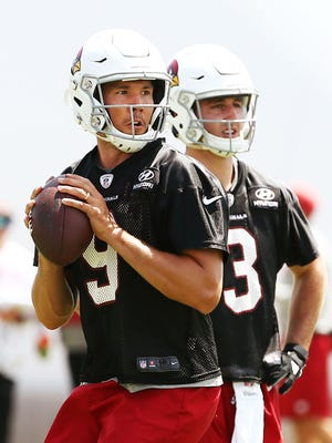 Arizona Cardinals quarterbacks Sam Bradford and Josh Rosen (right) during voluntary Organized Team Activities on June 5, 2018 at the Arizona Cardinals Training Facility in Tempe, Ariz.