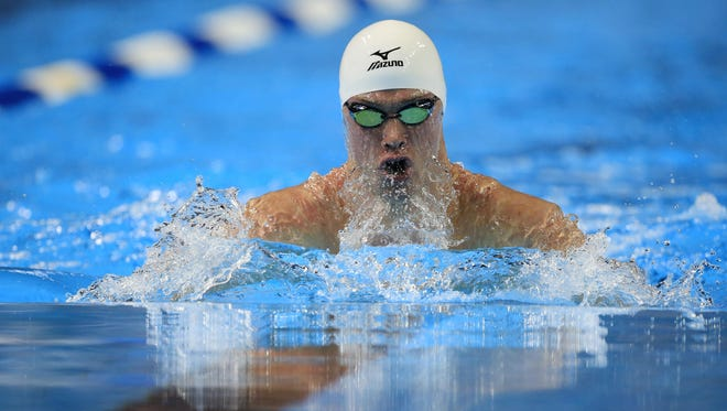 Kevin Cordes swims during a semifinal heat in the men's 100-meter breaststroke at the U.S. Olympic swimming trials in Omaha, Neb., on Sunday.
