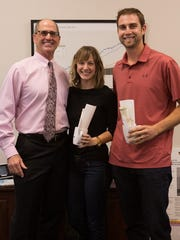 Nicole and John James stand with Bob Swift of the TCI
