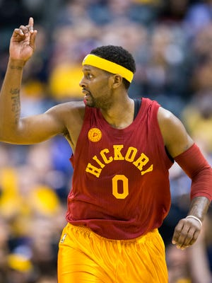 CJ Miles of Indiana signals after a shot he made during first half action against the Brooklyn Nets, Bankers Life Fieldhouse, Indianapolis, Sunday, April 10, 2016.