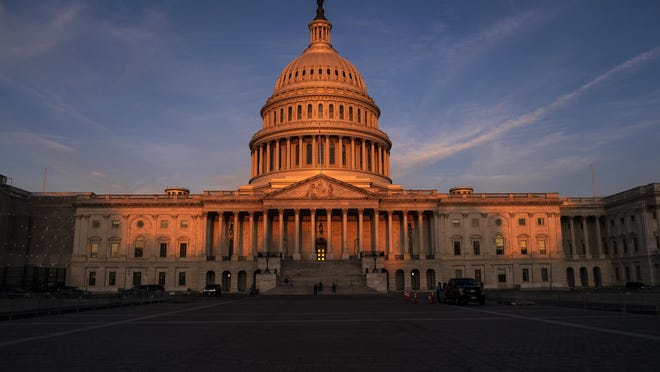 FILE - In this Sept. 25, 2019, file photo, the West Front of the U.S. Capitol in Washington. Impeachment may have leapfrogged to the top of the national agenda, but members of Congress still have their day jobs as legislators _ and they're returning to work this coming week with mixed hopes of success. (AP Photo/J. Scott Applewhite, File)