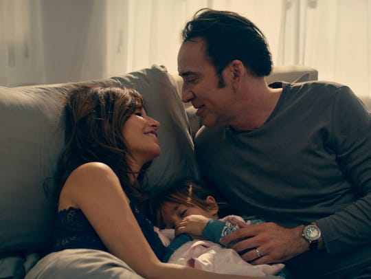 """Gina Gershon and Nicolas Cage in """"Inconceivable."""""""