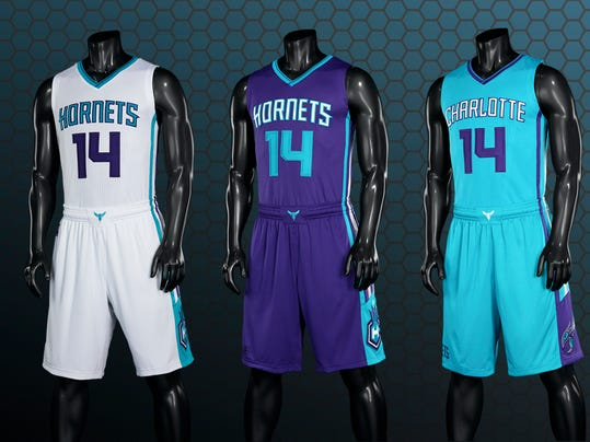 This image released by the Charlotte Hornets, shows the NBA basketball team's new uniforms. The team unveiled three new primary uniforms featuring white, purple and teal colors on Thursday, June 19, 2014, in Charlotte, N.C. (AP Photo/Charlotte Hornets)