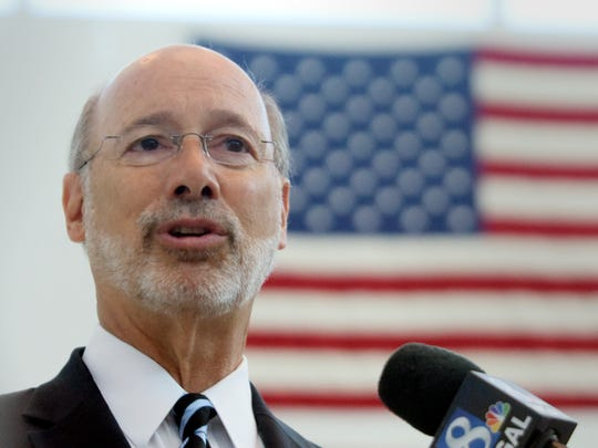 Governor Tom Wolf talks to reporters after touring