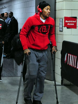Chicago Bulls point guard Derrick Rose (1) walks out of the Moda Center on crutches after being injured in the game against the Portland Trail Blazers. The Blazers won the game 98-95.